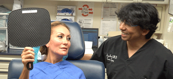 Dr. Amiya Prasad helping patient look better, and feel more confident